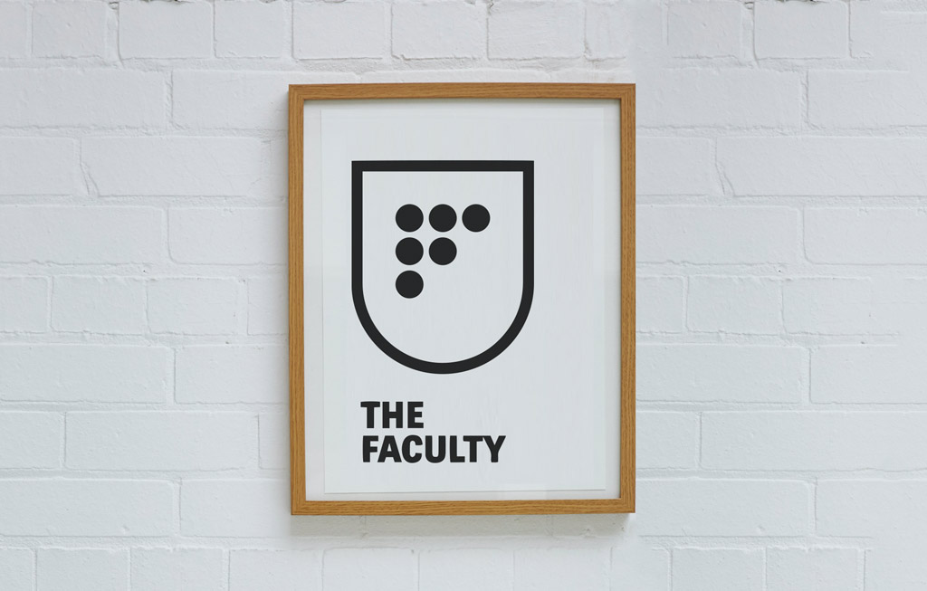 The Faculty logo in a frame